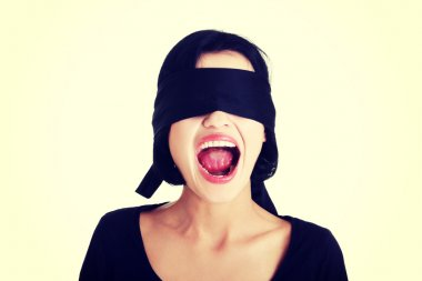 Blindfolded woman screaming