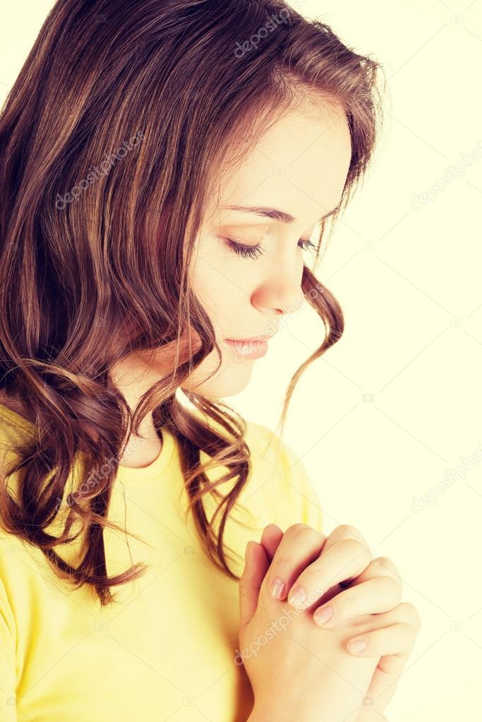 Caucasian girl praying
