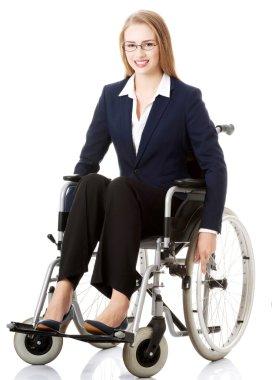 Businesswoman sitting on wheelchair.