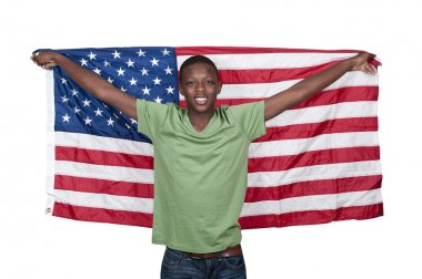 Handsome young teenaged black with the American flag stock vector
