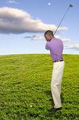 muž golfista