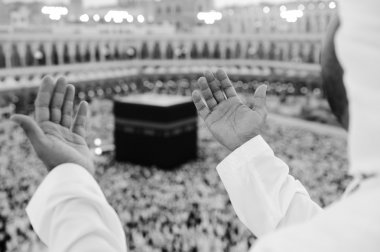 Muslim praying at Mekkah with hands up