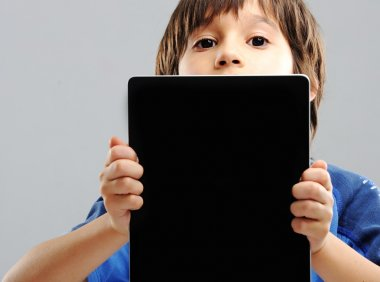 Cute little boy with Tablet PC