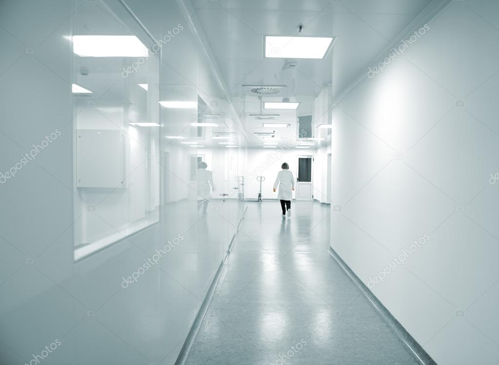 Modern bright factory interior with working in motion