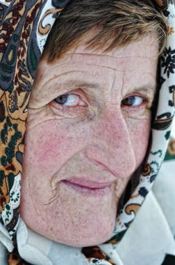 Elderly woman with scarf