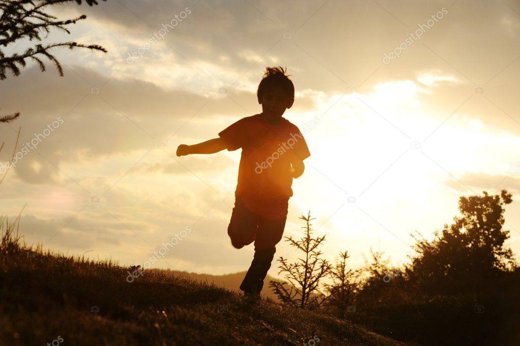 Kid running on meadow