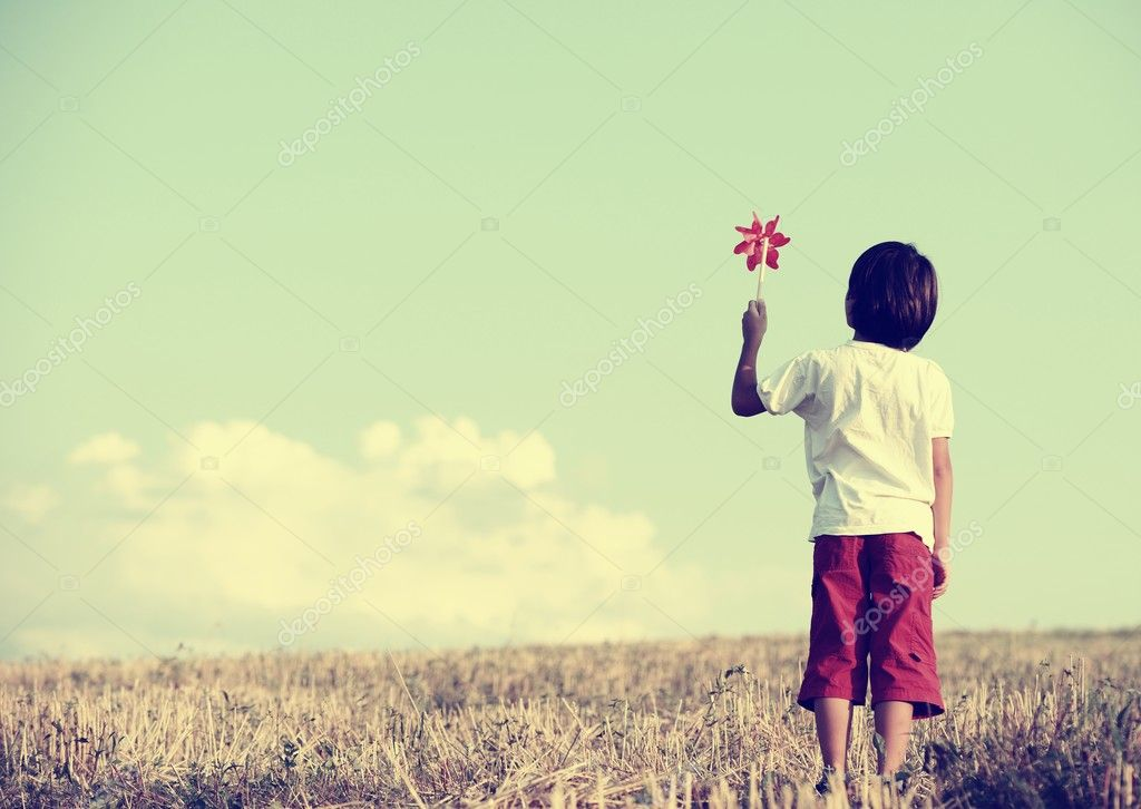 Kid standing in nature with large copy space
