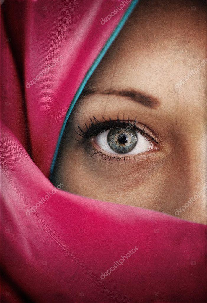 Half face in blue scarf