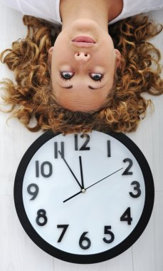 Girl and clock upside down