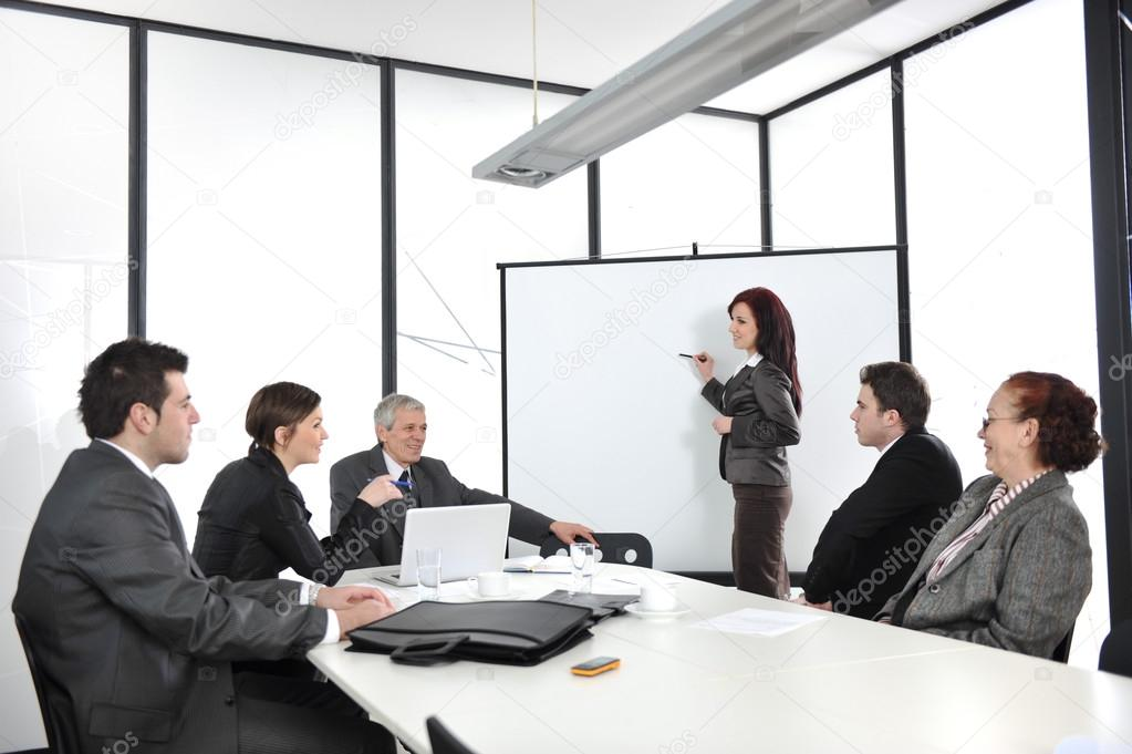 Businesswoman drawing a diagram during the presentation