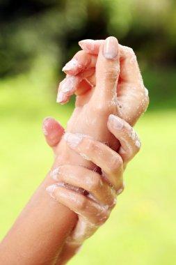 Beautiful hands in soap