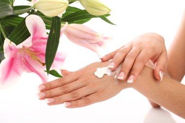 Woman applying cream on her hands