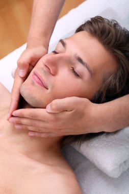 Handsome man enjoying face massage