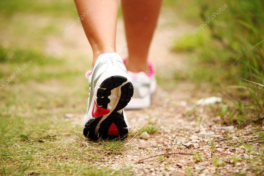 Female legs jogging on a trail