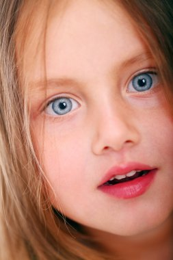 Little girl with big eyes looking at you
