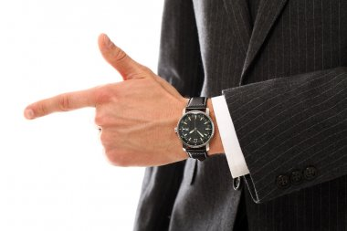 Closeup of businessman hand pointing on something