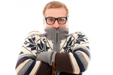 Guy in sweater feel cold over a white background