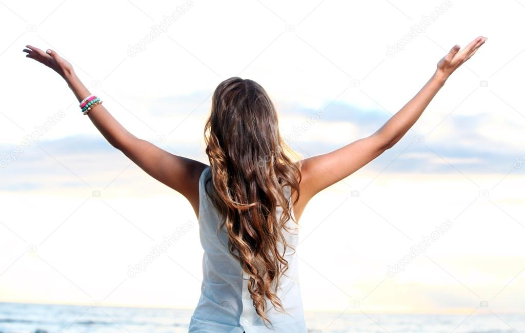 Beautiful girl posing near the sea