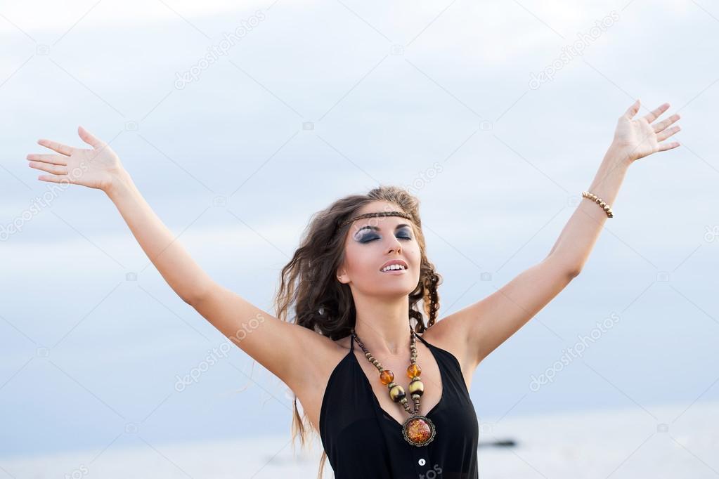 Woman in a dress on a beach