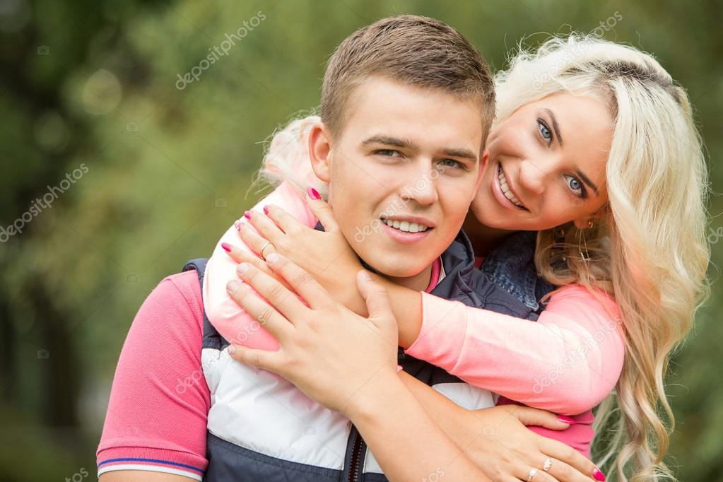 Young passionate couple at park
