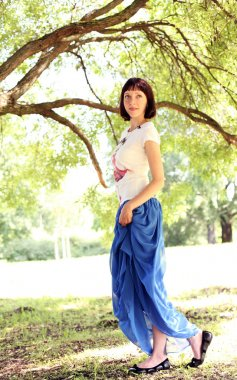 Woman walking by a tree