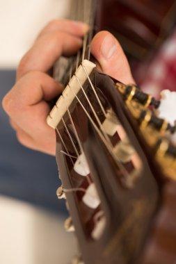 Musician holding a wooden guitar