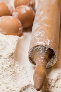 Rolling pin and eggs in flour