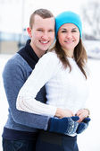 Fotografie Attractive couple on ice rink