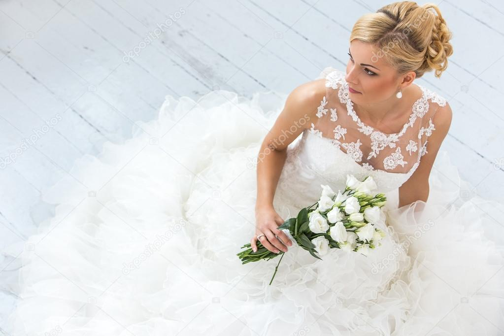 Attractive bride with bouquet