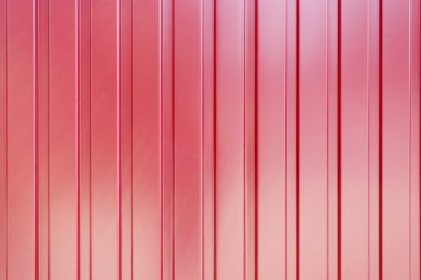 The red corrugated metal walls