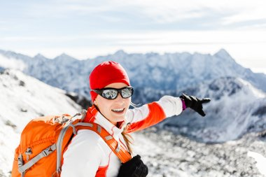 Hiking success, happy woman in winter mountains