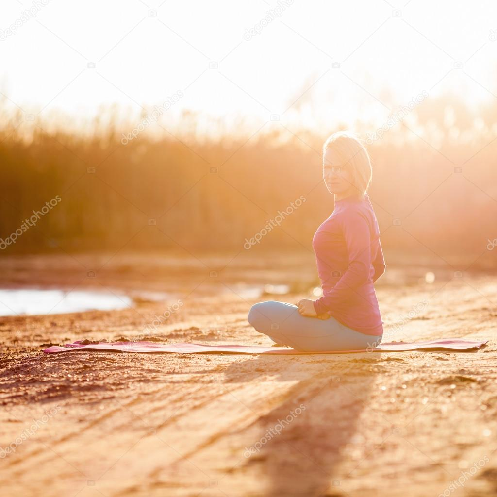 Yoga meditation, woman on sunset