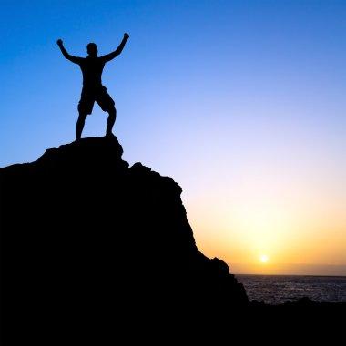 Man hiking success silhouette in mountain
