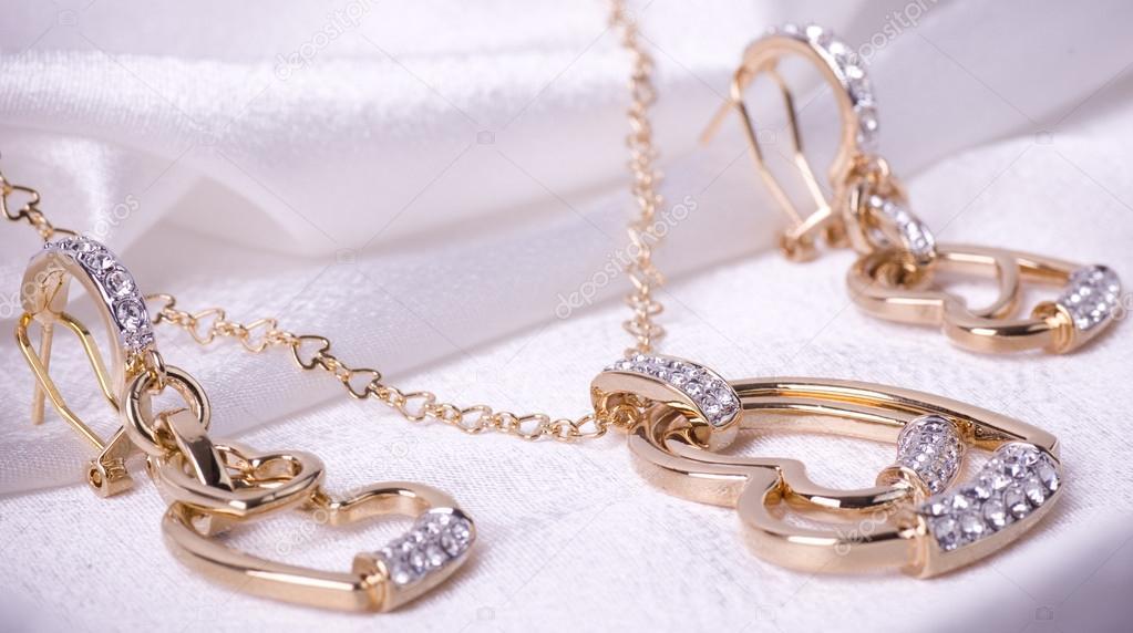 Beautiful jewelry on white background — Stock Photo © Forewer ...