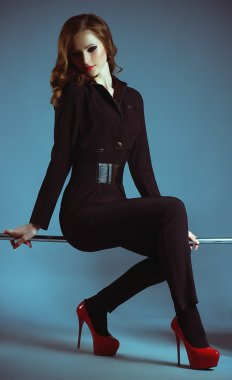 model in a black suit posing