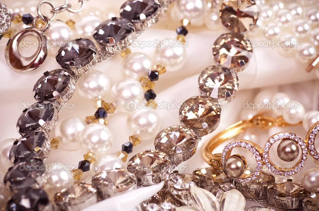 Beautiful jewelry on background — Stock Photo © Forewer #24505921