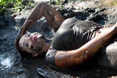 Woman lying in the mud