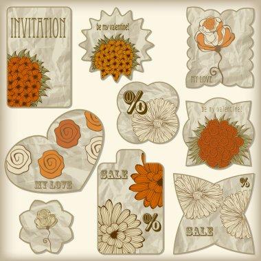 set of foil cut golden shiny vintage tagswith floral pattern,