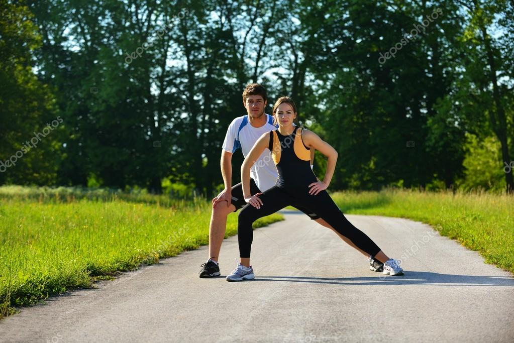 Couple doing stretching exercise after jogging