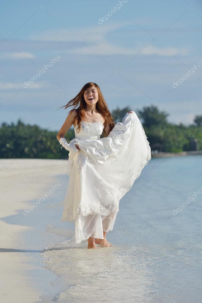 asian bride on beach — Stock Photo © .shock #18897675