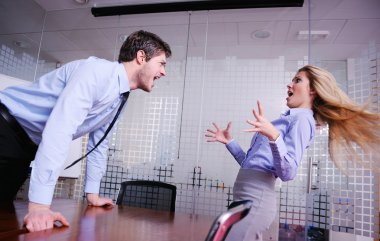 Angry busines sman screaming at employee