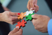 Photo Group of business assembling jigsaw puzzle