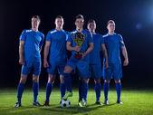 Fotografie Fotbaloví hráči slaví vítězství