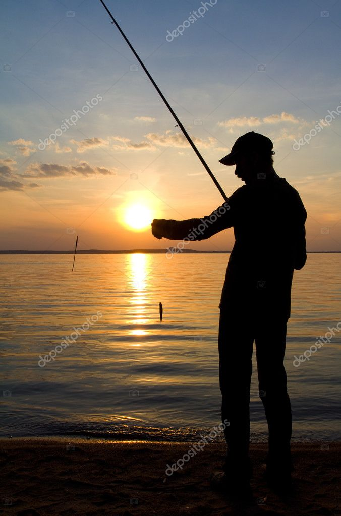 Fisherman fishing on sunset
