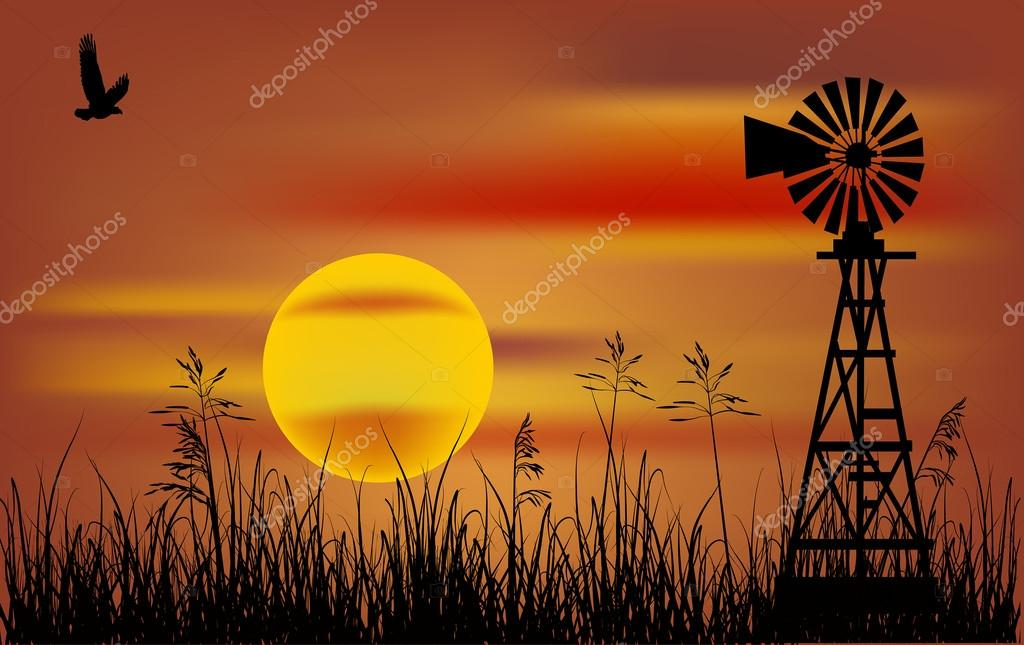 windmill in grass at sunset