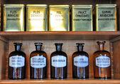 Fotografie Bottles on the shelf of an old pharmacy