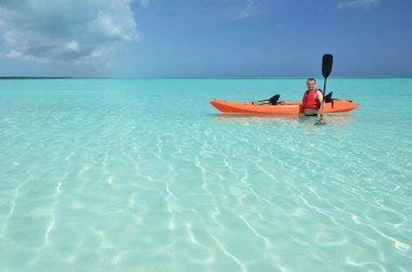 A man with kayak. Exuma, Bahamas