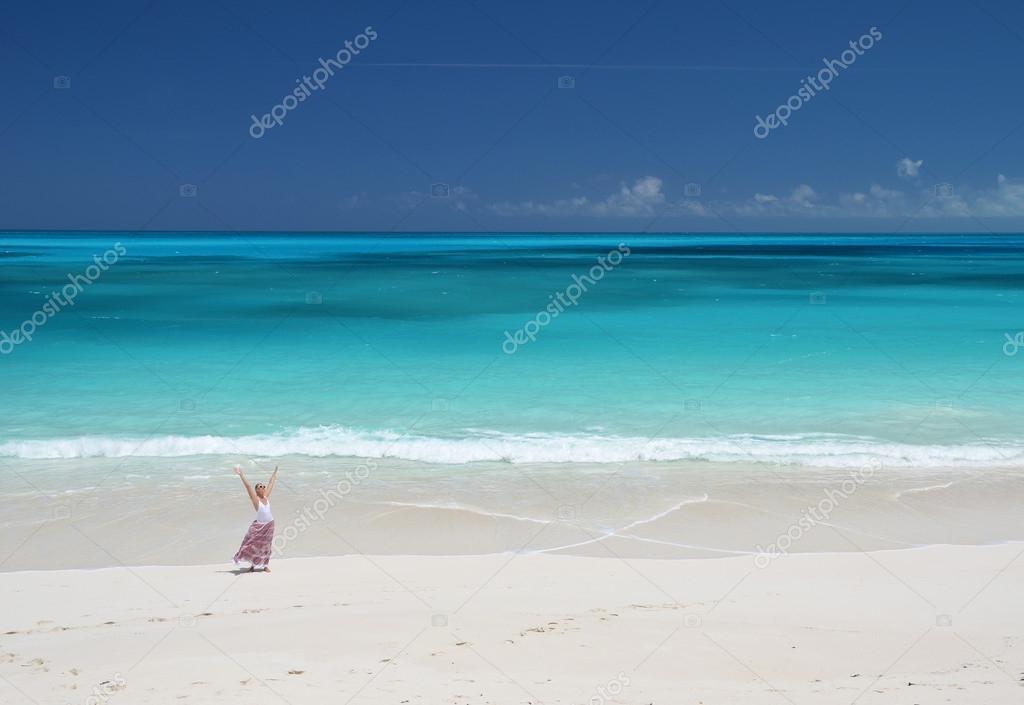 Girl on the desrt beach