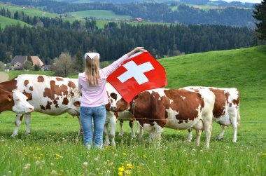 Girl holding Swiss flag