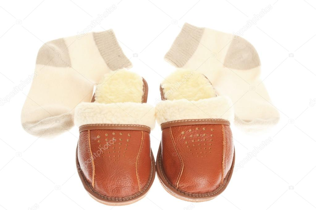 b3d0c7a631b Brown wool comfortable slippers and thick woollen socks - house slipper  isolated on white background — Photo by Dekkymek